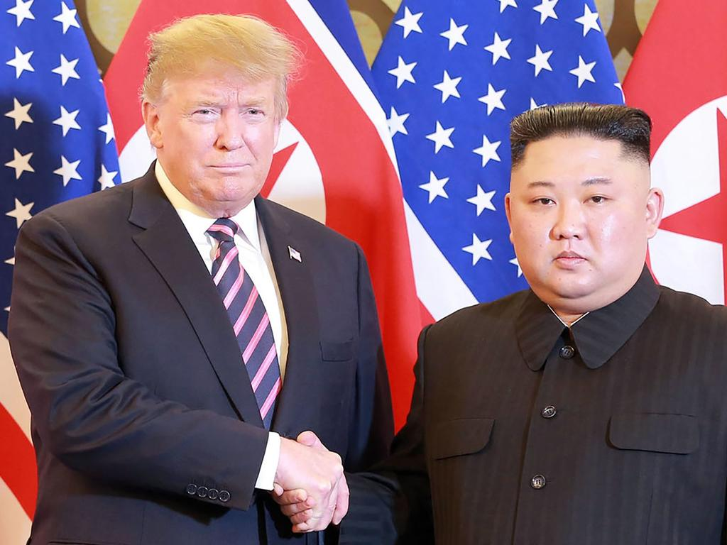 North Korean leader Kim Jong-un shakes hands with US President Donald Trump in Hanoi on February 27, their second face-to-face following the historic summit in Singapore last June. Picture: AFP PHOTO/KCNA VIA KNS