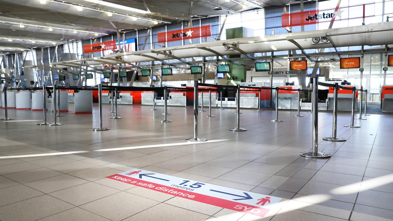 COVID-19 signage at Sydney Airport Domestic Terminal in May. Picture: Richard Dobson