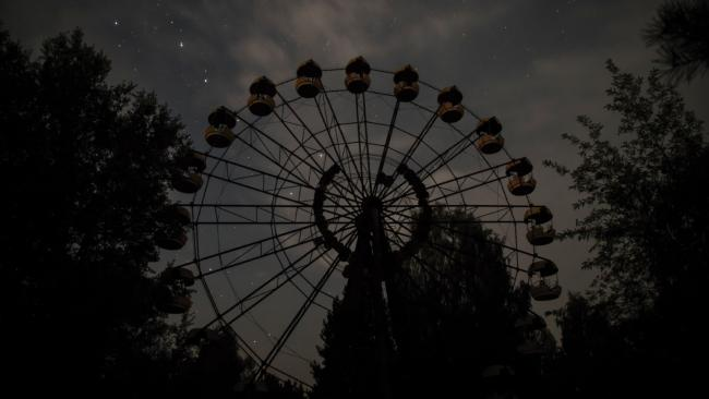 Ferris Wheel, Pripyat. Though the city was evacuated before its official May Day opening ceremony, the wheel saw occasional use before the disaster, contrary to popular belief. Picture: Darmon Richter/FUEL Publishing