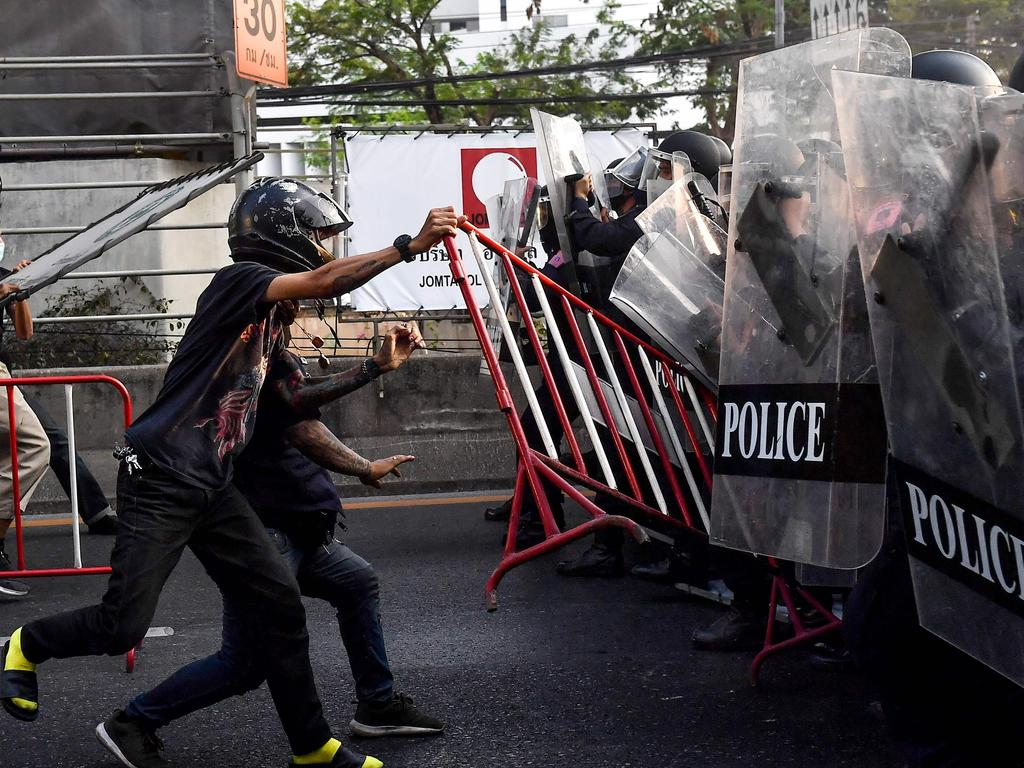 Thai pro-democracy protesters throw a barricade at riot police in Bangkok, in the area where Myanmar migrants were demonstrating: Picture: Lillian Suwanrumpha/AFP