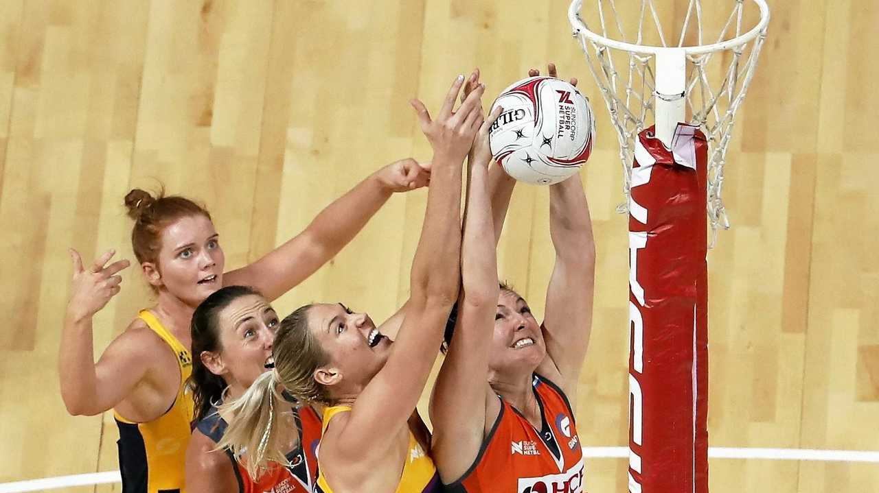 COLLISION COURSE: Stephanie Wood (L) and Caitlin Bassett (3rd L) of the Lightning fight for a high ball against Bec Bulley (2nd L) and Sam Poolman (R) during the Round 14 Super Netball match between the Giants and the Sunshine Coast Lightning at the Qudos Bank Arena, Sydney Olympic Park last month. Picture: DANIEL MUNOZ