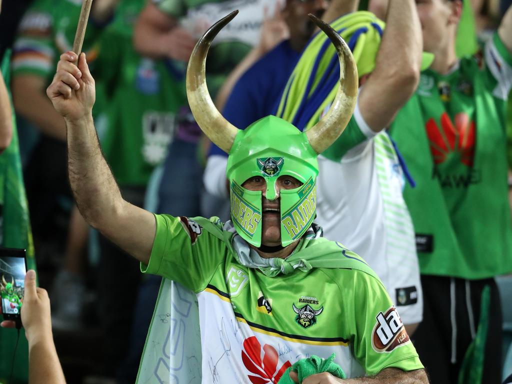 Raiders fan Simon Tayoun throws his support behind Canberra during the 2019 NRL grand final. Picture: Jonathan Ng