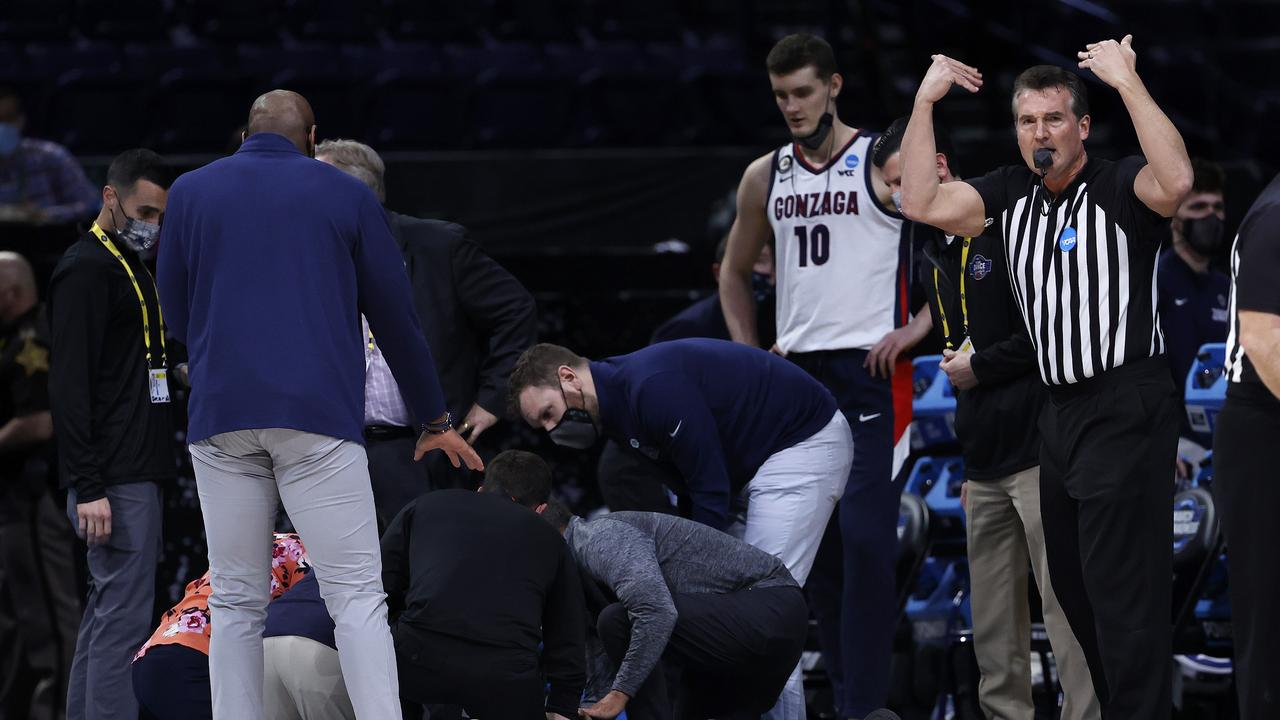 Referee Bert Smith is tended to by training staff and medical officials. (Photo by Jamie Squire/Getty Images)