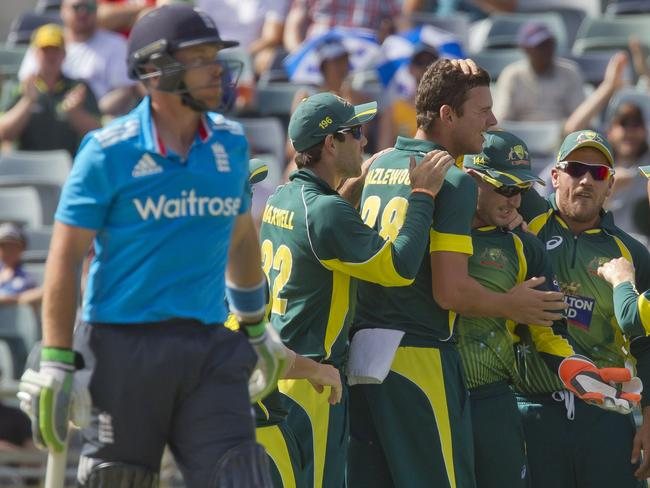 Josh Hazlewood is mobbed by his teammates after removing Ian Bell in the final at the WACA.
