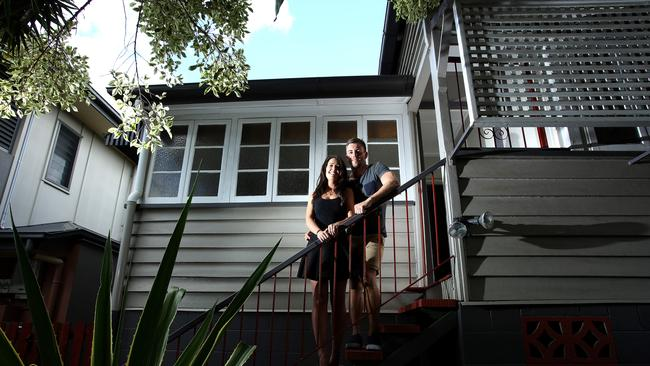 Daniel Ogden (with partner Emer Tector, 27) first-home buyer who bought last month and is now saving up to renovate his home at address is 41 Brassey St, Ascot. For a RE liftout story on how the market is performing. Pic Mark Cranitch.