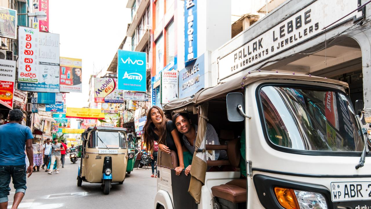 One of the best ways to see the bustling city is in a tuk-tuk.