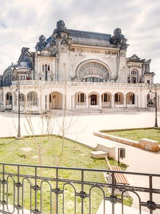 PIC BY ROMAN ROBROEK/ CATERS NEWS - (PICTURED: The exterior of the abandoned casino) - These are the haunting images that reveal how luck ran out for an abandoned Romanian casino. Self-confessed urban-obsessed photographer Roman Robroek, from south of the Netherlands, captured the eerie shots at Casino Constanta in Romania. The art deco style structure was commissioned by King Carol I and built in 1900, before flinging open its door to gamblers in 1910. But maintaining the impressive building proved to be too much for the local authorities and it was shut down in 1990. SEE CATERS COPY.