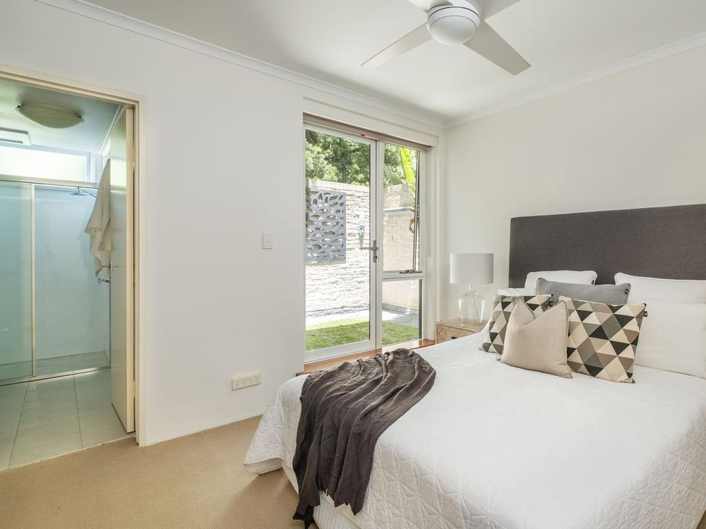 The main bedroom has its own courtyard and ensuite bathroom.