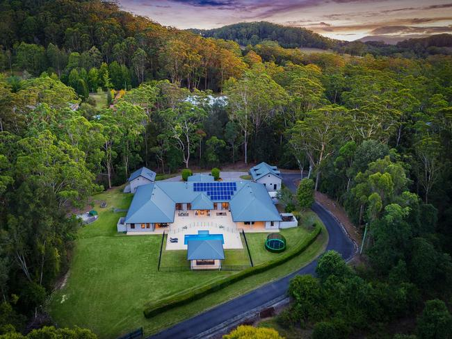 Set upon 5 private north-facing acres.