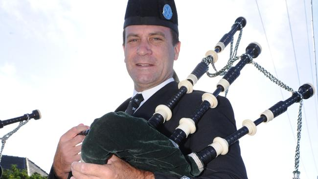 State MP Geoff Shaw plays the bagpipes at an Anzac Day march.
