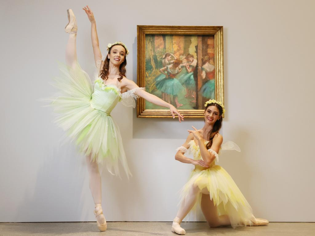 Laura Tosar and Chiara Gonzalez with the 19th century Edgar Degas painting 'Dancers, Pink and Green'. Picture: Lachie Millard