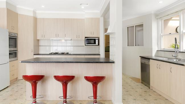 The kitchen has a stainless steel double oven.