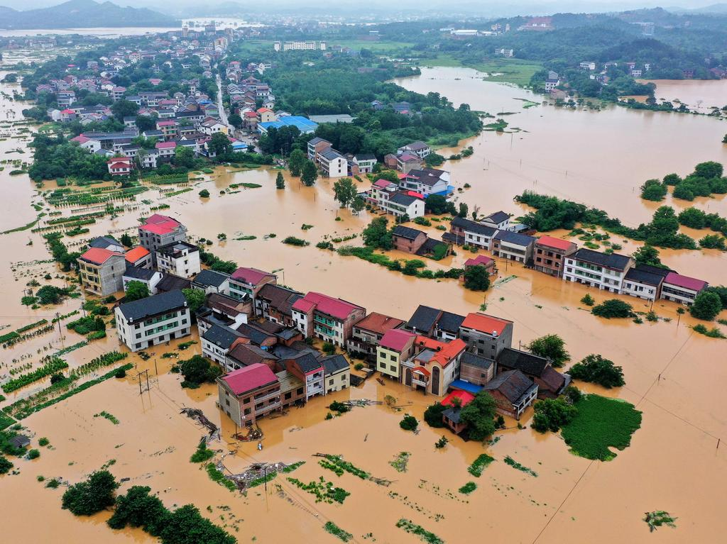 Submerged buildings after heavy rain caused flooding in Hengyang in southern China's Hunan province. Picture: STR/AFP