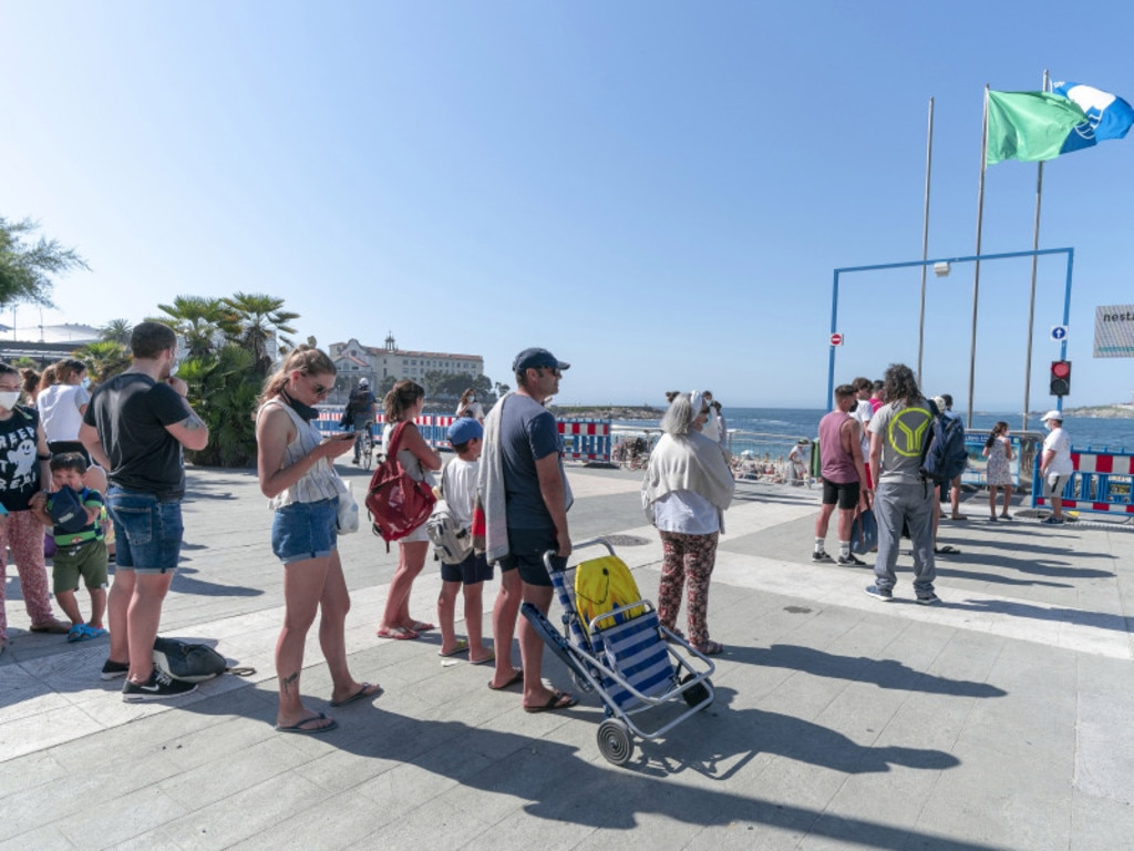 People have had to queue for the beach in Spain.
