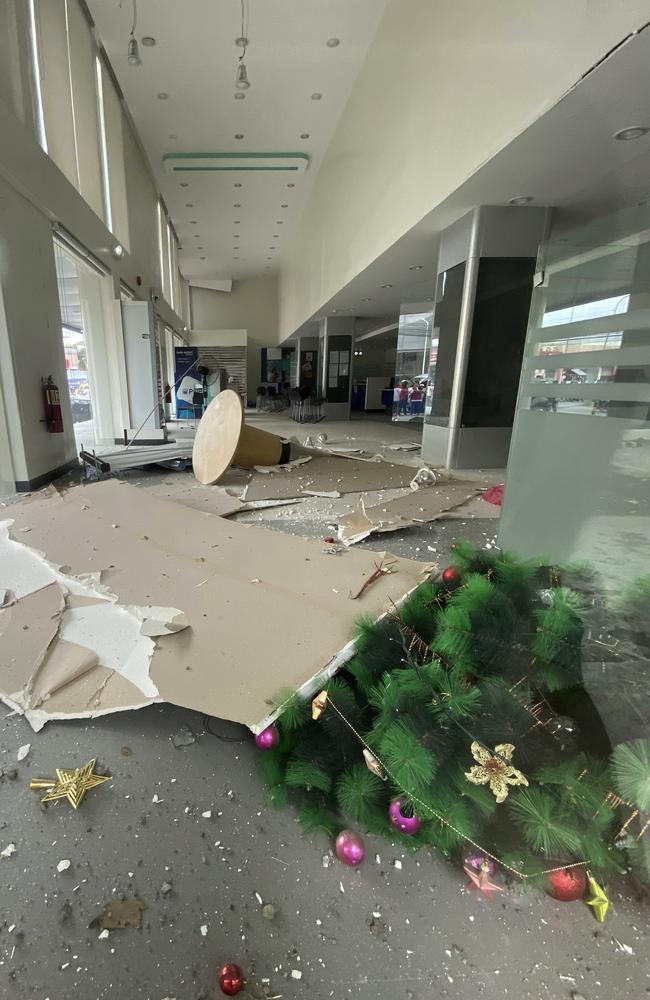 A Christmas tree and other debris lie on the ground inside a building after a strong earthquake shook the southern Philippines. Picture: Philippine Red Cross via AP