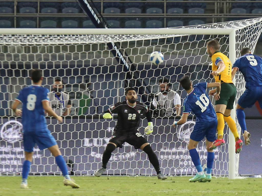 Mathew Leckie scores for Australia against Kuwait. Picture: Yasser Al-Zayyat / AFP