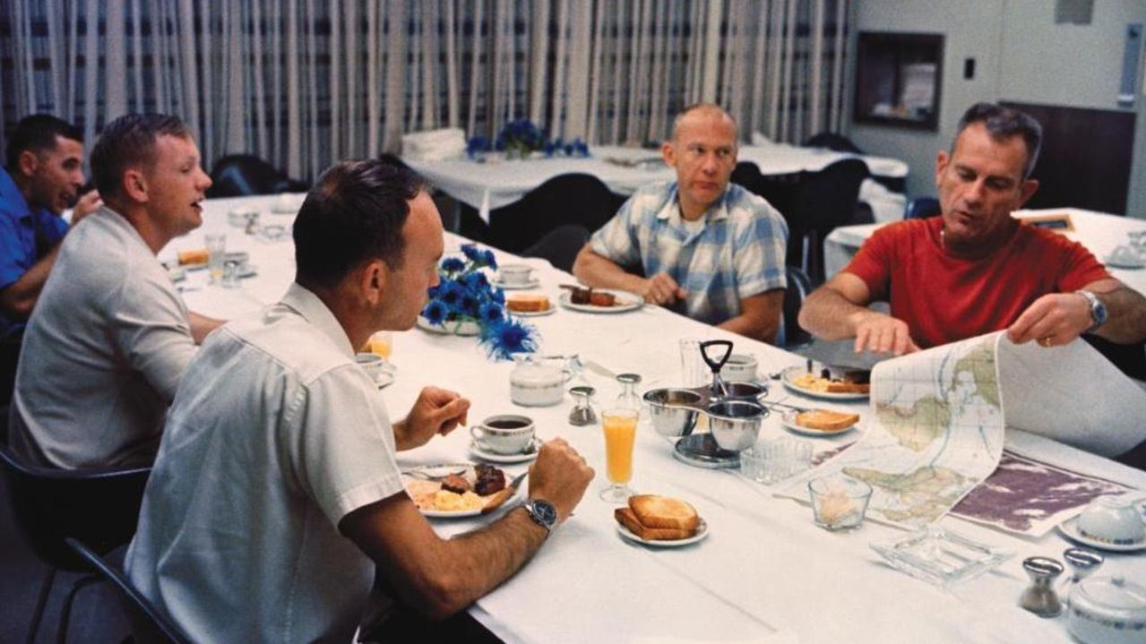 Supplied  Apollo 11 astronauts Neil Armstrong, Michael Collins and Buzz Aldrin  enjoyed a pre-launch meal at @NASAKennedy before suiting up for the mission.  Liftoff was at 9:32 am EDT.
