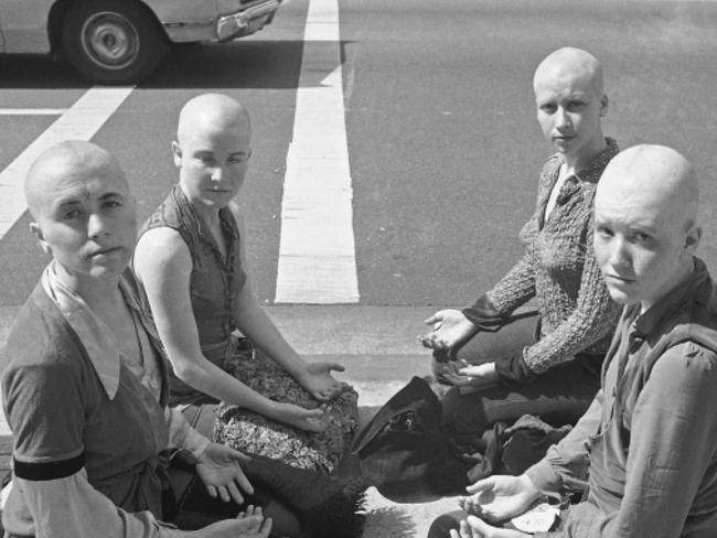 Members of the Manson Family with shaved heads outside the courthouse where their leader was being tried for multiple murder in 1991. Picture: AP.
