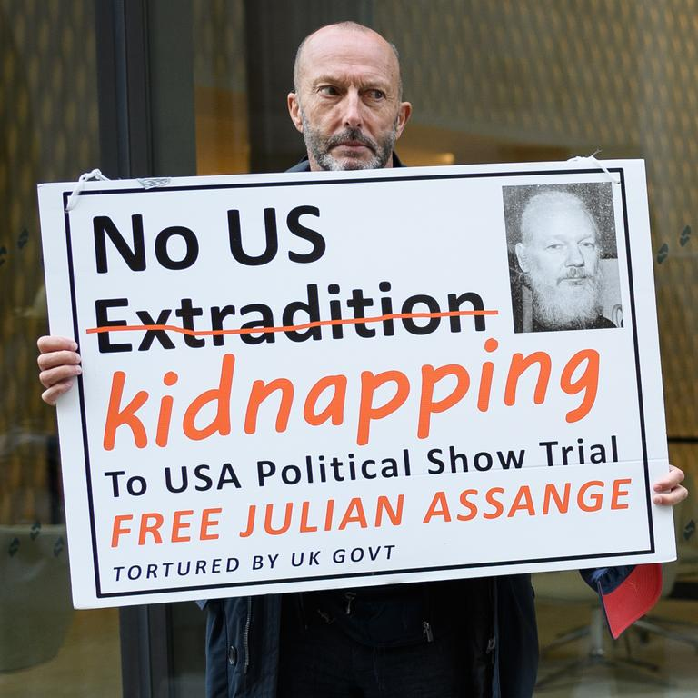 An Assange supporter outside a court that heard the US had tried to allegedly kidnap Julian Assange from the Ecuadorian embassy. Picture: Leon Neal/Getty Images