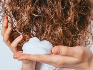 Keep thirsty curls hydrated and clean. Image: iStock