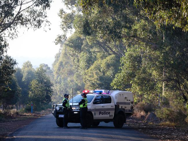 A police roadblock outside the property in Osmington. Picture: AAP