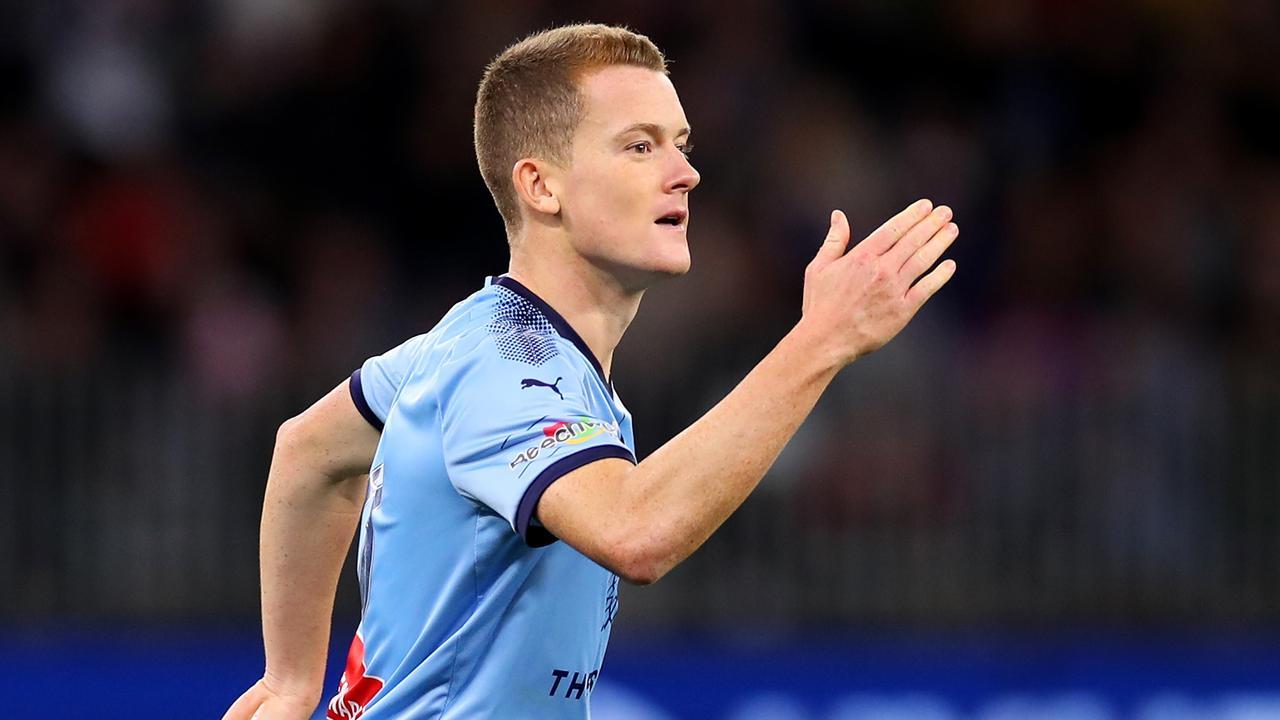 Brandon O'Neill celebrates slotting a penalty in the A-League grand final shootout.