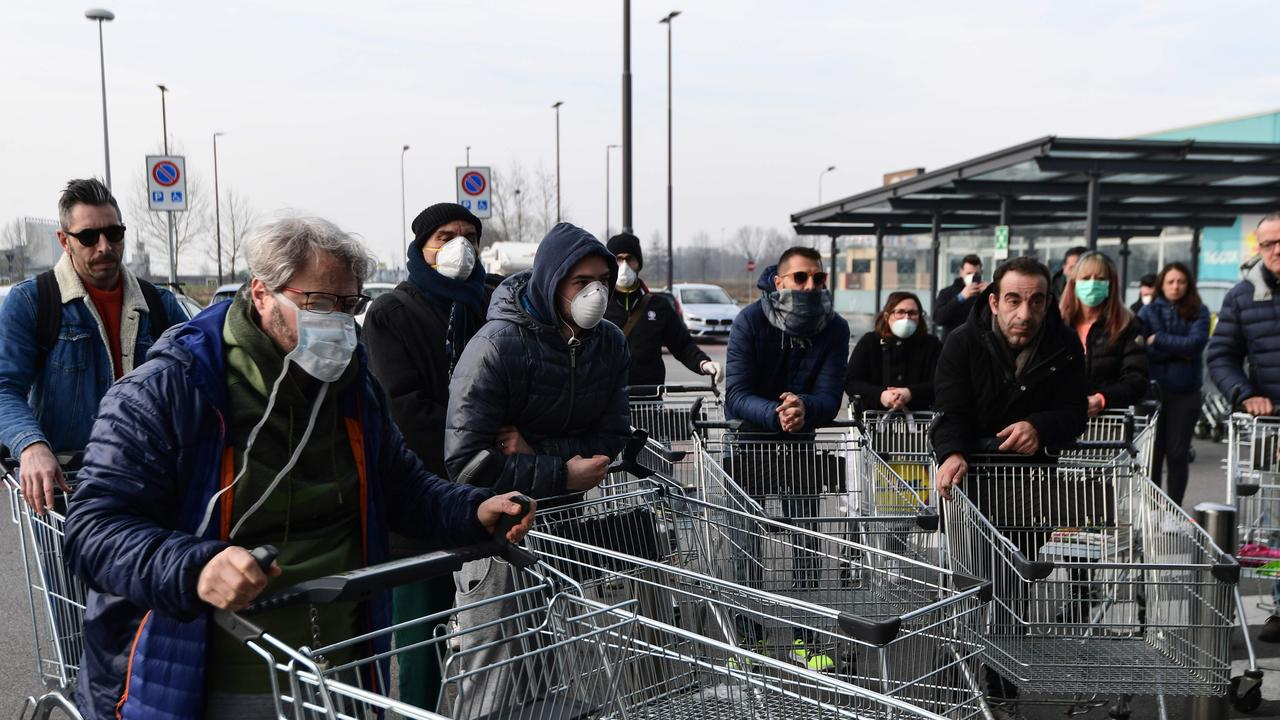 Residents wait to be access a supermarket in the small Italian town of Casalpusterlengo due to fears of a coronavirus pandemic. Picture: Miguel Medina/AFP