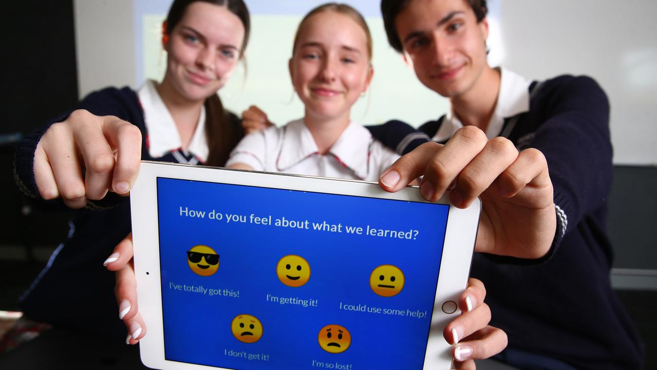 Students Piper, Mia and Jez have been trialling using emojis to give instant feedback to teachers in class at St Andrews Lutheran, Tallebudgera, Qld. Picture: Adam Head