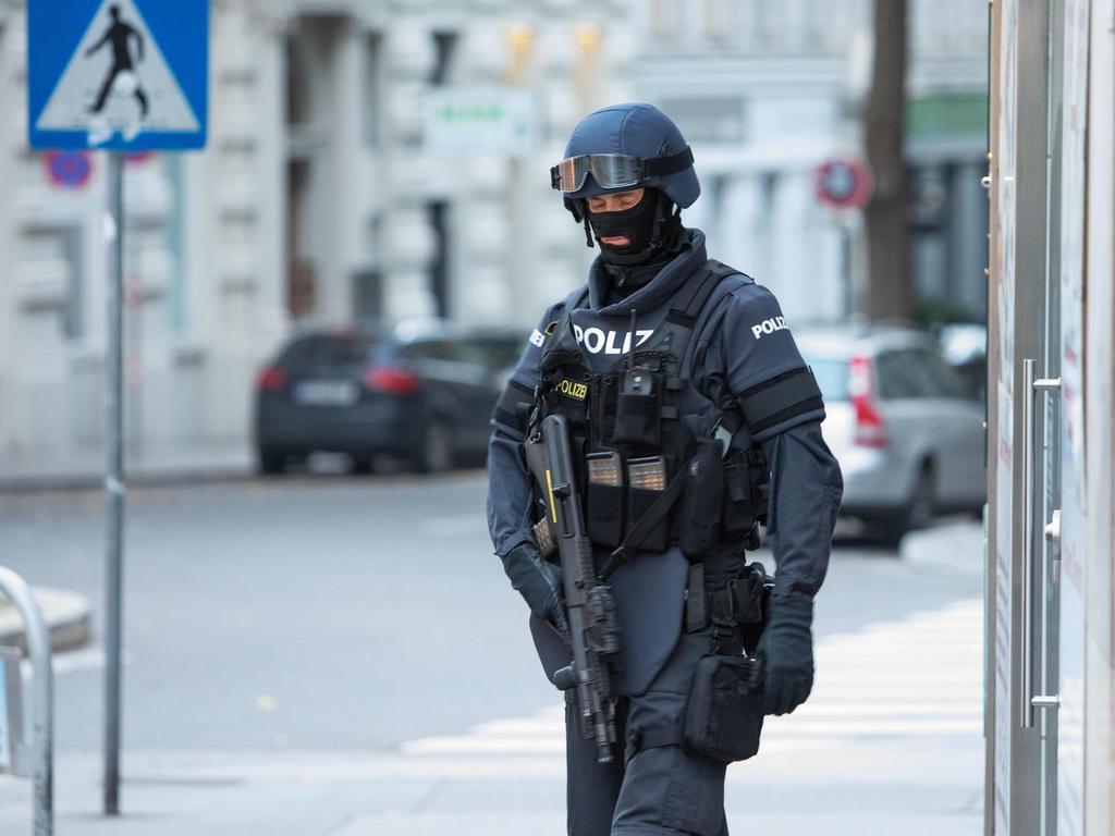A police officer patrols near Morzinplatz in downtown Vienna. Picture: Alex Halada/AFP