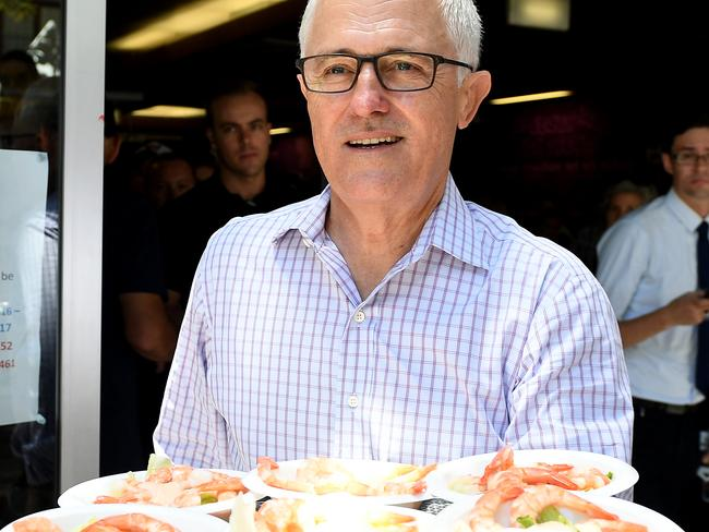 The prime minister helps serve lunch as they attend the Wayside Chapel Christmas Day service in Sydney. Picture: Dan Himbrechts/AAP