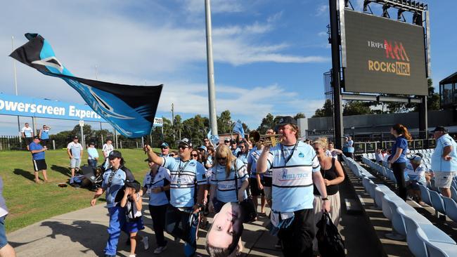 Sharks fans arrive at the stadium at Shark Park.