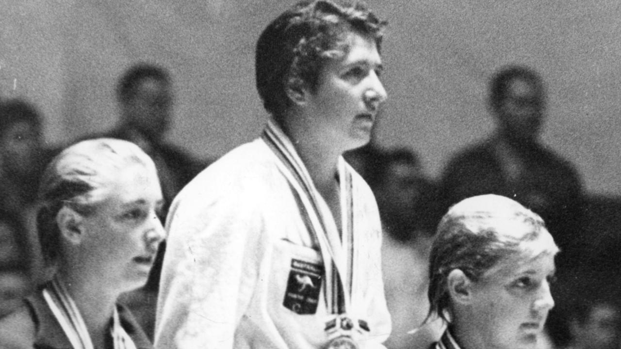 Three in a row: Dawn Fraser after receiving her gold medal for the 100m freestyle at the 1964 Olympic Games in Tokyo.