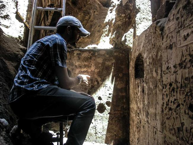 Clean-up detail ... Mud, rubble and sewage is cleaned from the memorial chapel's walls. Picture: Luxor Times.