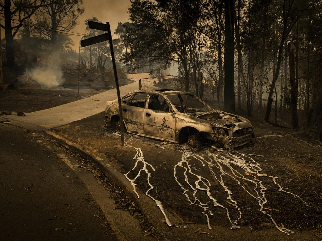 Second prize in the Spot News Stories category. Aluminium was pictured streaming from a burning car in Conjola Park bushfires razed more than 89 properties. Picture: Matthew Abbott, Panos Pictures for The New York Times, World Press Photo via AP