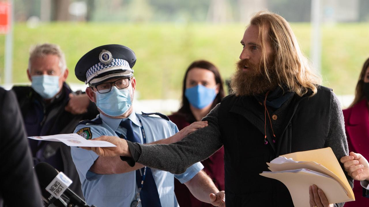 He attempted to hand a document to Mick Fuller. Picture: James Gourley/NCA NewsWire