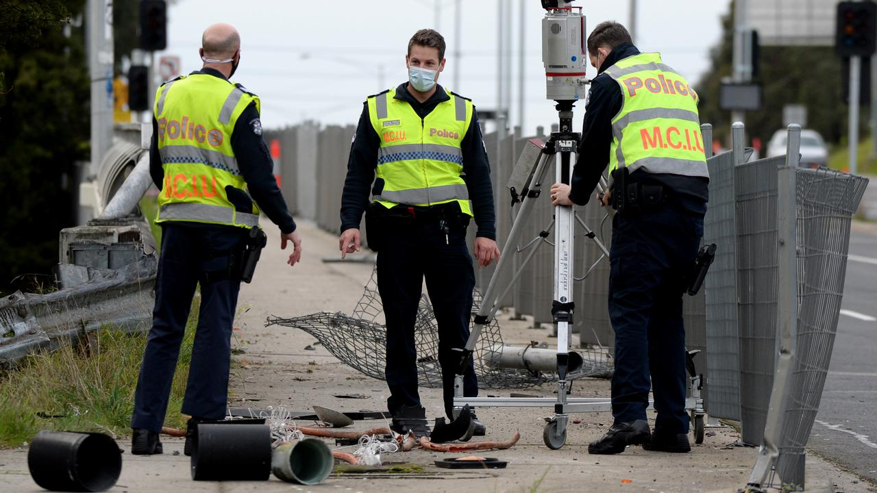 Police inspecting debris from the crash. Picture: Andrew Henshaw