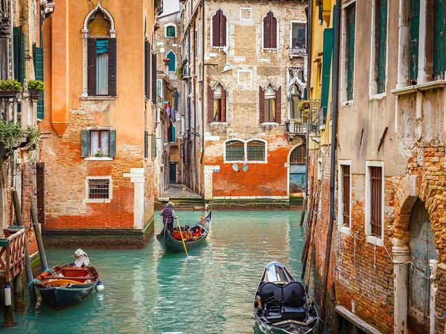HAVE A GONDOLA RIDE THROUGH THE CANALS As cliche as it may seem, there truly is no better way to get a taste of that quintessential Venetian culture than being rowed around the crumbling canals of Venice by a singing gondolier — striped shirt and all.