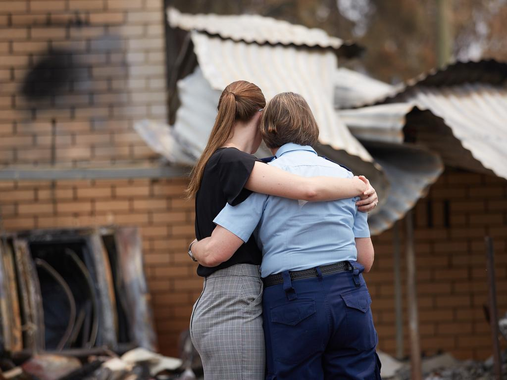Community strength ... after the fires, Australians are still helping each other to rebuild. Many of their stories feature in Fighting Spirit.