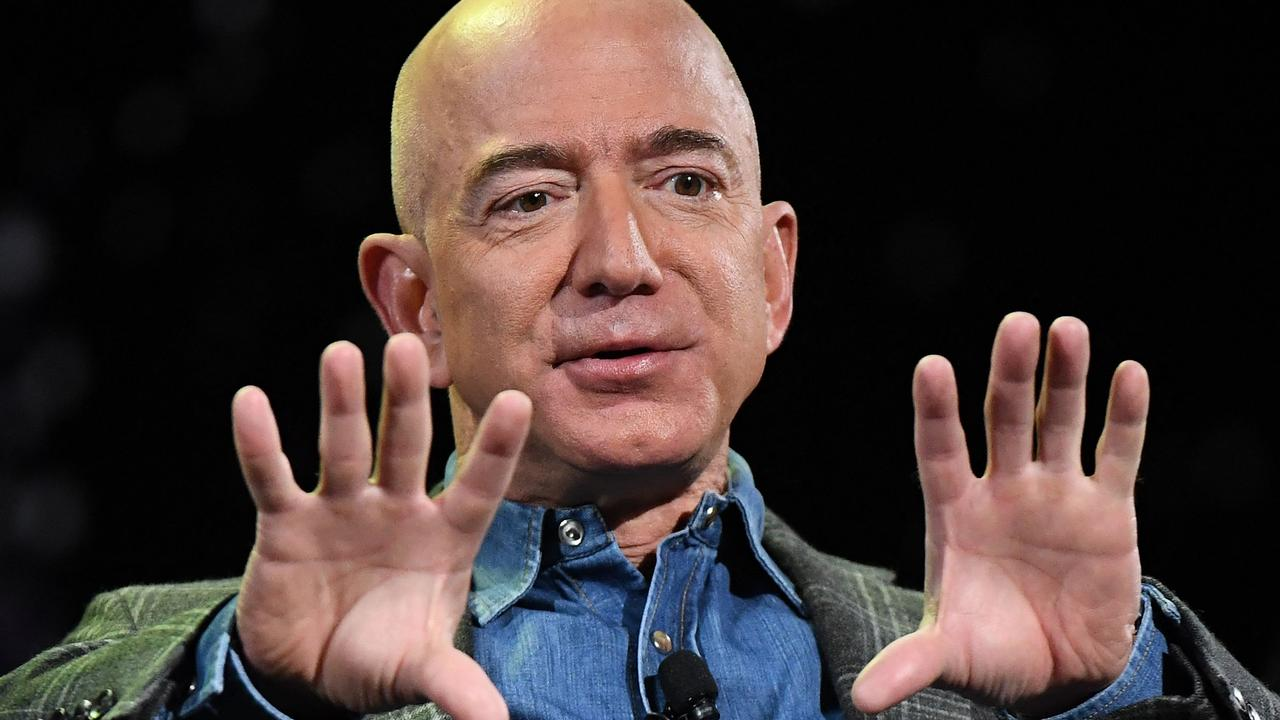 He is expected to dedicate more time toward initiatives like the Bezos Earth Fund, his Blue Origin spaceship company. Picture: Mark Ralston / AFP