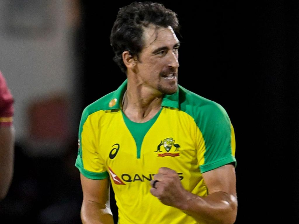 Mitchell Starc (R) of Australia celebrates winning the 4th T20I between Australia and West Indies at Darren Sammy Cricket Ground, Gros Islet, Saint Lucia, on July 14, 2021. (Photo by Randy Brooks / AFP)