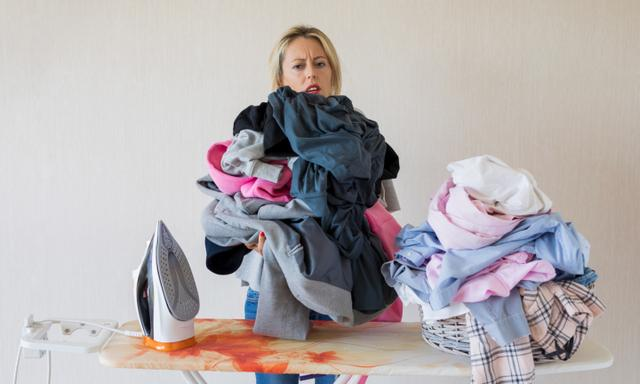 Female exhausted by never ending laundry piles