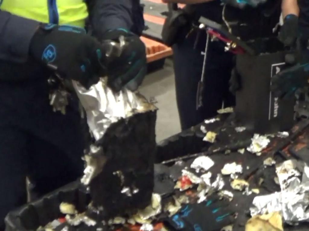 Officers uncovering the drug haul hidden in audio equipment bound for Melbourne. Source: AFP