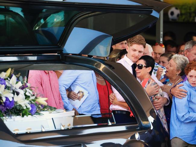 Julie Dixson surrounded by family at the funeral of daughter Jade, at Buderim on the Sunshine Coast.