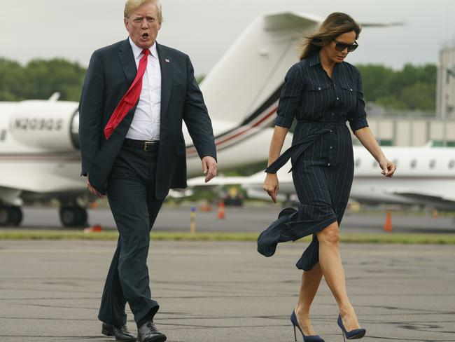 Mr Trump and first lady Melania walk from Marine One to board Air Force One on their way back to Washington. Picture: AP Photo/Carolyn Kaster