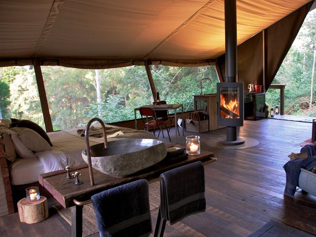 """1/14Nightfall CampNightfall Camp, in Lamington National Park, Queensland, offers luxury tent accommodation the owners describe as """"high-end, raw-luxe"""". The eco tents have rotating woodfires, vintage tin-baths, rain-head showers, hand-basins carved from rock and king-sized beds. You can choose to bring your own food - each tent has a micro kitchen and a private BBQ - or be treated to Nightfall's fire-cooked organic cuisine."""