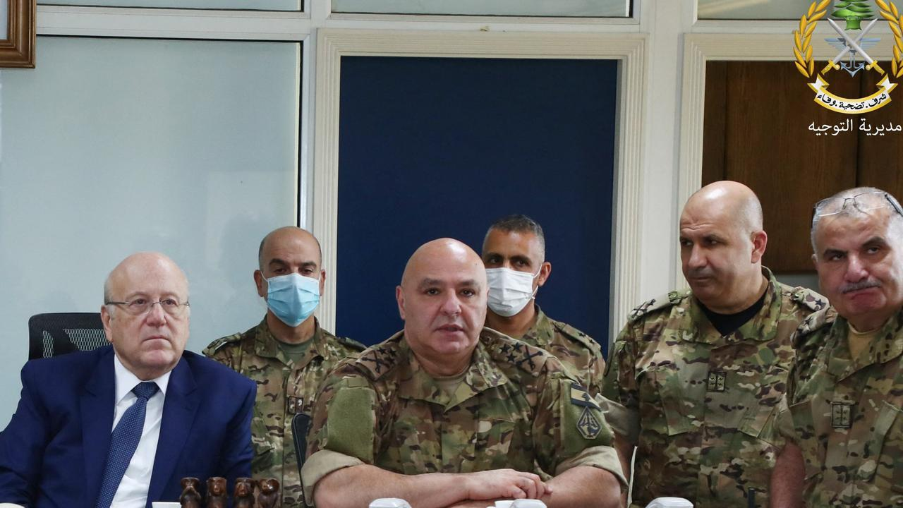 Lebanon's Prime Minister Najib Miqati (L) meeting with Lebanese Army Chief Joseph Aoun (2nd L) and other military officials at the ministry of defence in Yarze, on the eastern outskirts of the capital Beirut.