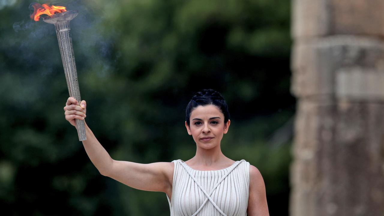 An actor as high priestess, holds a torch with the Olympic flame during the 2012 lighting of the flame ceremony in Ancient Olympia, Greece. The flame is always lit in the birthplace of the Ancient Olympics. Picture: AP Photo
