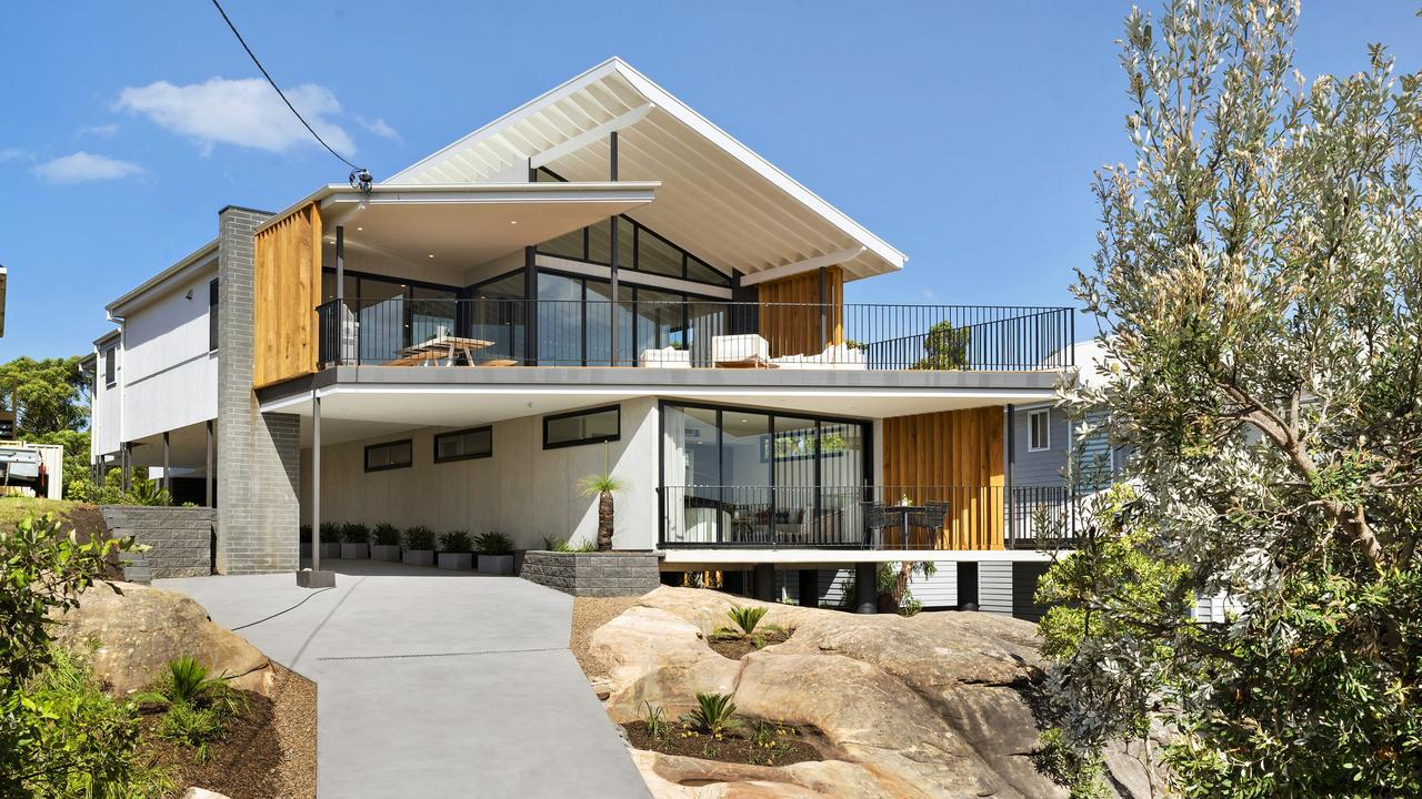 The incredible property is built around a rock's edge.