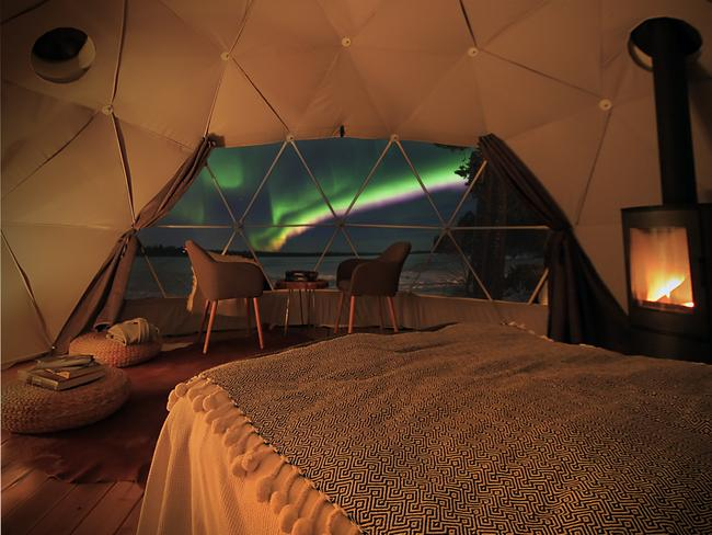 """HOW MUCH? A night's stay in an Aurora Dome can be included in a seven-night """"See the Northern Lights in Torassieppi"""" holiday with The Aurora Zone, from about $3120 per person. For accommodation only, domes start from about $440 per night. harriniva.fi Picture: Jarven Rannalla / theaurorazone.com"""