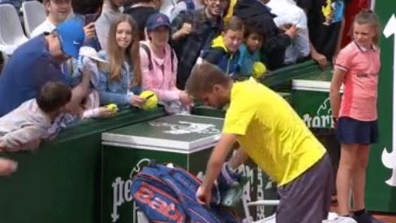 A fan rips a towel away from a child.